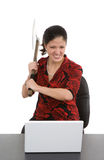 Computer Problems. Woman taking battle axe to computer out of frustration Royalty Free Stock Images