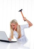 Computer problems with a hammer and a laptop Stock Photo