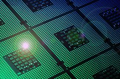 Computer Processor aligned with light effects. Background Stock Images