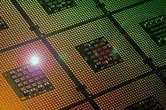 Computer Processor aligned with light effects. Background Royalty Free Stock Images