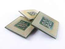 Computer processor chips. Closeup of three computer processor chips.  White background Stock Photos