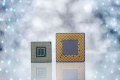 Computer Processor Chips On Light Background. Two Computer Processor Chips On Light Background With Reflection And Abstract Connection Net Royalty Free Stock Images