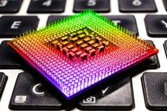 Computer processor closeup on laptop keyboard background. Toned image Stock Photos