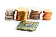 Computer processor and coins Stock Image