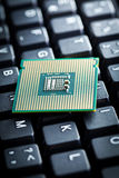 Computer processor on computer keyboard Stock Photo