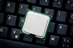 Computer processor on computer keyboard Royalty Free Stock Photos