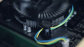 Computer processor cooling system closeup. Central processing unit cpu rotary cooling fan and radiator stock video
