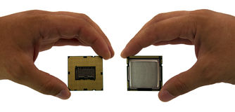Computer processor in hand Stock Images