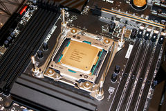Computer processor installed on motherboard. Computer processor installed on LGA socket on black professional motherboard stock photo