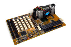 Computer Processor Motherboard with Card Slots. Stripped computer motherboard with card slots outside cpu case isolated on white Royalty Free Stock Images