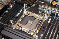 Computer processor motherboard socket. Empty computer processor socket on black professional motherboard royalty free stock photos