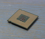 Computer processor on a wooden background Stock Photography