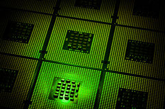 Computer processors aligned with green lighting effects postproduction Stock Photo