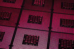 Computer processors aligned with lighting effects postproduction Royalty Free Stock Photos
