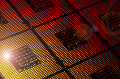 Computer processors aligned with lighting effects postproduction Stock Image