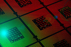 Computer processors aligned with red and green lighting effects postproduction Stock Image