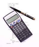 Computer program, pen and calculator Royalty Free Stock Photos