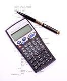 Computer program, pen and calculator royalty free stock photos