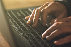 Computer programmer and hacker hands typing laptop keyboard Royalty Free Stock Images
