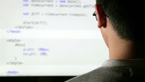 Computer programmer at work coding stock video footage