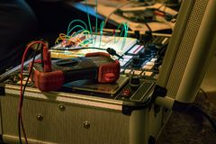Computer programming device. Circuitry and wiring equipment on a messy desk Stock Image