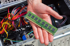 Computer ram data. Hand with new ram data for computer Royalty Free Stock Photos