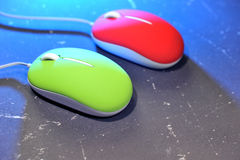 Computer red and green mouse. Mouse for computer or laptop on the mouse pad Royalty Free Stock Photography