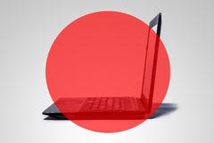 A computer with a red, transparent circle. Stock Photos
