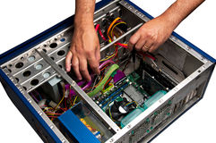 Computer Repair Service. Computer being repaired by technician Stock Image
