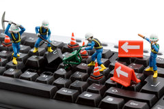 Computer repair. Concept - workers repairing keyboard Stock Images