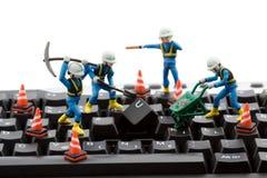 Computer repair. Concept - workers repairing keyboard Stock Photos