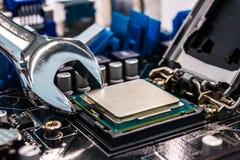 Computer repair. Broken computer repair with the instrument Stock Photography