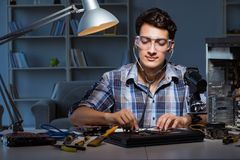 The computer repair concept with man inspecting with stethoscope. Computer repair concept with man inspecting with stethoscope Royalty Free Stock Images