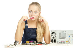Computer Repair Engineer. Blonde girl Royalty Free Stock Images