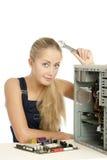 Computer Repair Engineer. Blonde girl Royalty Free Stock Images