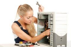 Computer Repair Engineer. Blonde girl Stock Photos