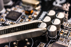 Computer repair, installation capacitor Stock Images