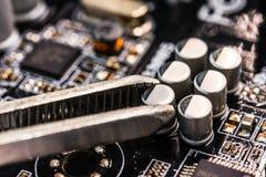 Computer repair, installation capacitor Stock Images