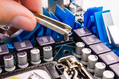Computer repair, installation motherboard Royalty Free Stock Photos