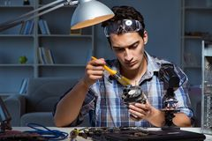 The computer repair man cleaning dust with brush. Computer repair man cleaning dust with brush Stock Image