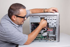 Computer Repair. Technician fixing a computer Royalty Free Stock Images