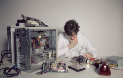 Computer Repair. Computer technician is trying to repair a computer Royalty Free Stock Photos