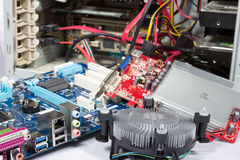 Computer repair or upgrade. Open pc and parts at it Royalty Free Stock Photo