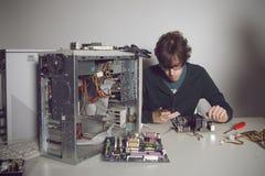 Computer Repair. Young man using cellphone Royalty Free Stock Photos