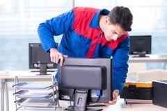 The computer repairman specialist repairing computer desktop. Computer repairman specialist repairing computer desktop Royalty Free Stock Image