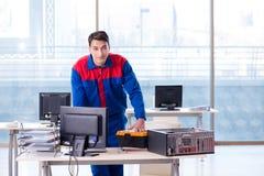 The computer repairman specialist repairing computer desktop Stock Image