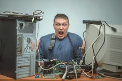 Computer repairman. Computer technician engineer. Support service. Overloaded enraged computer repairman engineer swears into the phone. Computer technician. PC Stock Image