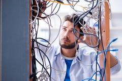 The computer repairman working on repairing network in it workshop Royalty Free Stock Images