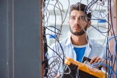 The computer repairman working on repairing network in it workshop Stock Photo