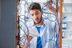 The computer repairman working on repairing network in it workshop Stock Images